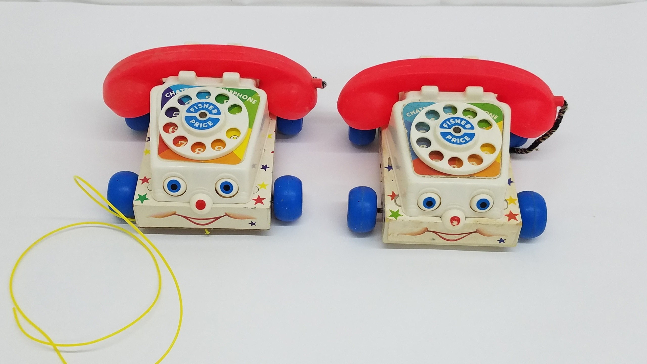 2 Fischer Price 747 Chatter Telephones 1 Wood and 1 Plastic Base